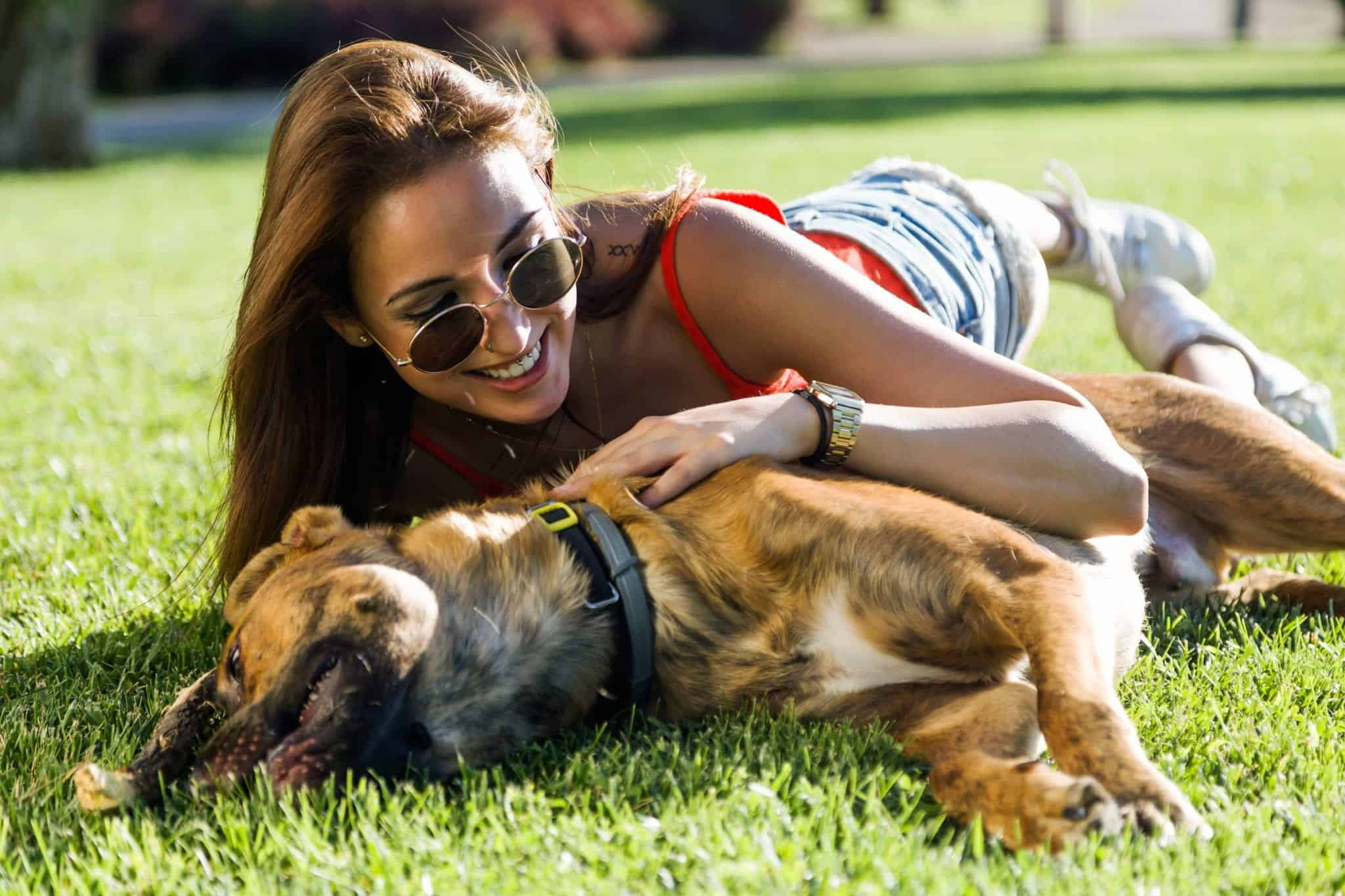 Canva Beautiful Young Woman Playing with Her Dog scaled