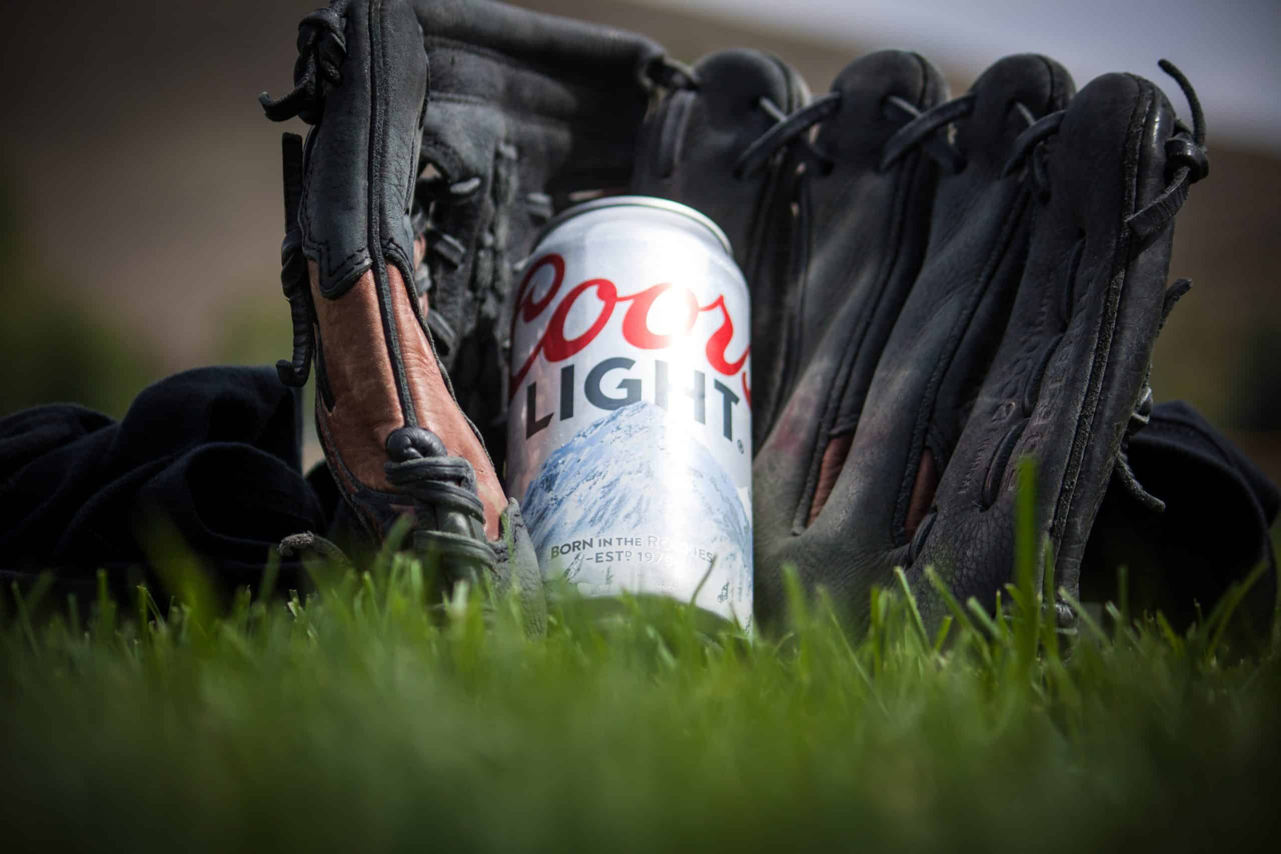Canva Close Up Photography of Coors Light Beer Near Black Baseball Mitts scaled